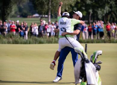 Pavan celebrates victory in Germany with his caddie.