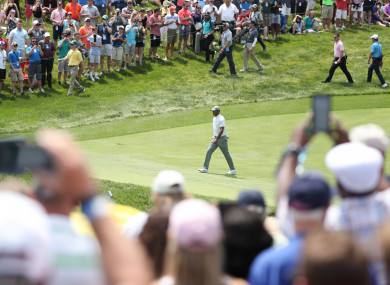 Tiger Woods approaches the 18th green during the third round of The Memorial Tournament.