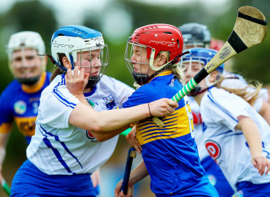 Tipperary's Karen Kennedy with Keeley Corbett Barry of Waterford.