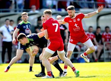 Kildare's Kevin Feely in action against the Tyrone defence.