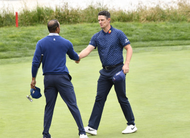 Justin Rose and Tiger Woods shake hands during the second round at Pebble Beach.