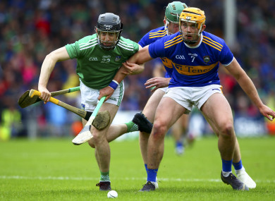 Graeme Mulcahy and Ronan Maher in action last Sunday in the Gaelic Grounds.