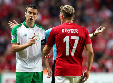 Coleman speaks with Denmark's Jens Stryger following a confrontation with Jeff Hendrick.