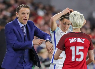 Neville with Rapinoe during a SheBelieves clash between England the USA.