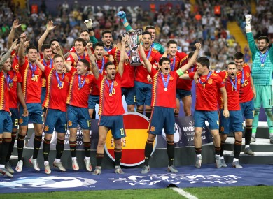 Spain players lift the trophy at the Stadio Friuli in Italy.