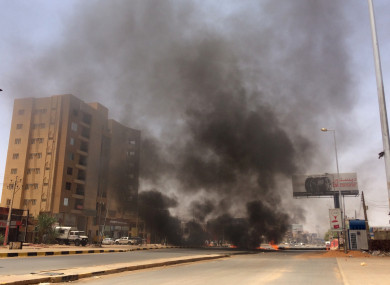 Burning tires set alight by protesters near Khartoum's army headquarters in Sudan