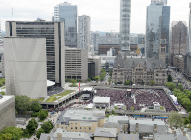 Fans pictured at Nathan Phillips Square at City Hall ahead of the 2019 Toronto Raptors Championship parade in Toronto.
