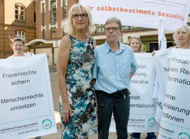 Dr Bettina G (l) and Dr Verena W stand with supporters before the Berlin court.