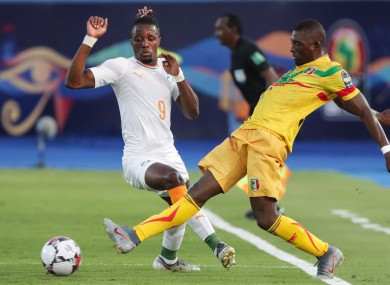 Zaha competes for possession with Mali''s Hamari Traore.
