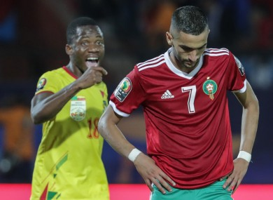 Hakim Ziyech reacts to his missed penalty.