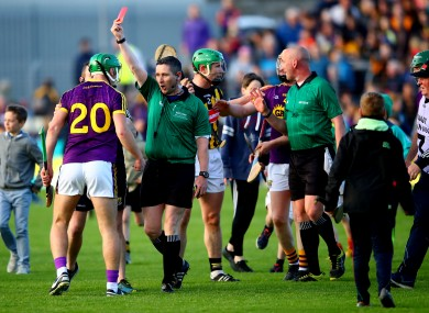 Nolan receiving a red card from Fergal Horgan after Wexford's draw against Kilkenny.