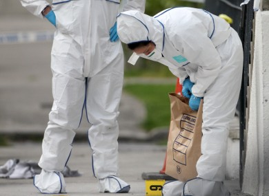 Forensic experts at the scene of the fatal shooting of Real IRA boss Alan Ryan in Clongriffin in Dublin in 2012.
