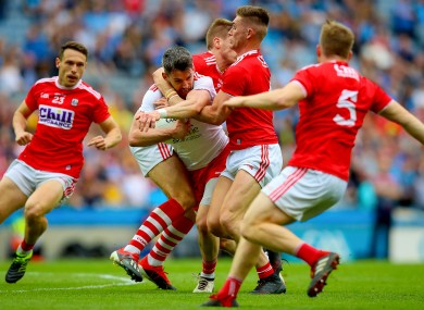 Cork's Ian Maguire and Kevin Flahive stop Matthew Donnelly of Tyrone.