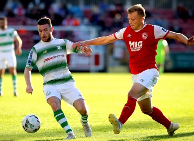 Jack Byrne of Shamrock Rovers under pressure from St Patrick's Athletic's Jamie Lennon during Monday's game between the clubs.