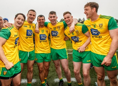 Hugh McFadden (right) celebrates with his Donegal team-mates after the Ulster final.