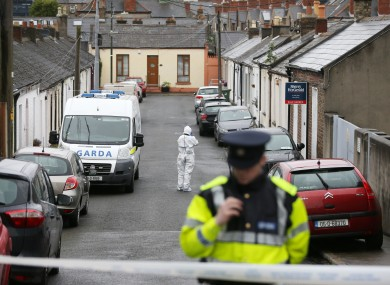 Gardai around the area of the scene where a man was stabbed to death on Friday morning