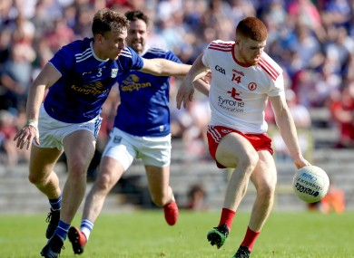 Cathal McShane in action for Tyrone against Cavan's Padraig Faulkner.