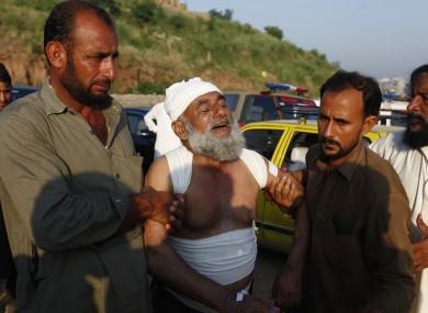People help an injured victim following the crash.