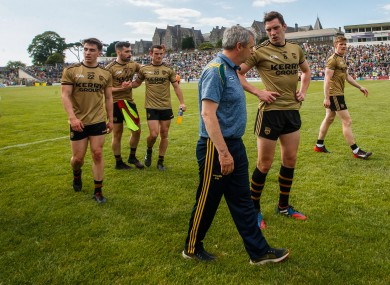 Peter Keane and David Moran leave the field after beating Mayo.