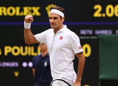 Roger Federer celebrates on Centre Court.