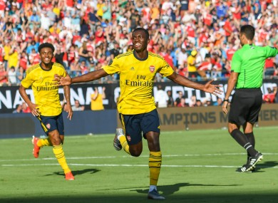 Nketiah celebrates scoring for Arsenal.