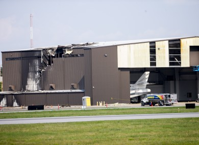 Damage is seen to a hangar after a twin-engine plane crashed into the building at Addison Airport in Addison, Texas,