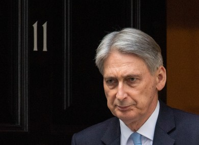 Philip Hammond leaves 11 Downing Street in Westminster, London.