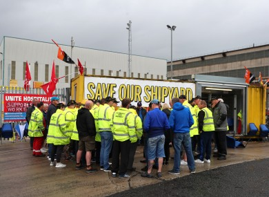 Harland and Wolff workers listen to union officials from Unite and GMB today
