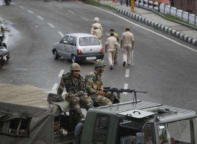 Indian army soldiers guard during restrictions in Jammu, India,