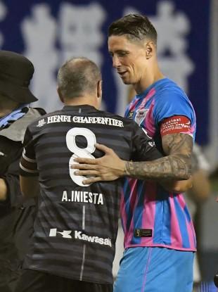 Torres and Iniesta shake hands.