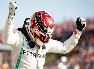 Mercedes driver Lewis Hamilton celebrates winning the Hungarian Grand Prix