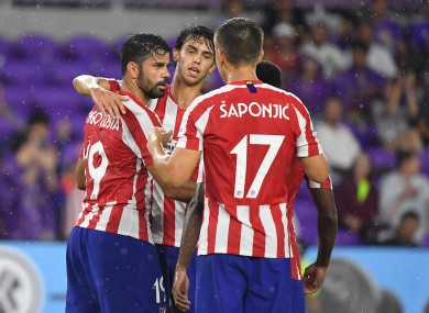 Joao Felix is congratulated by team-mates Diego Costa and Ivan Saponjic.