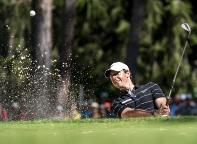 McIlroy plays his way out of the sand yesterday.