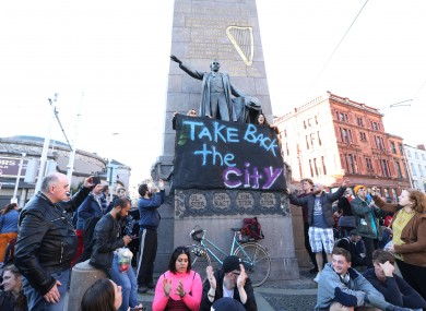 Take Back the City activists protest on Parnell Street in Dublin