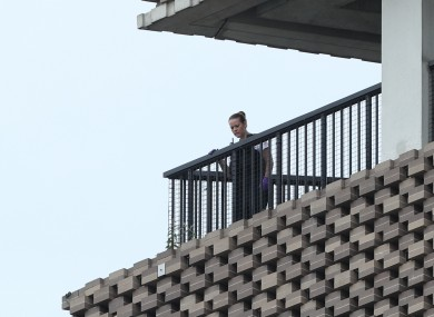 A police officer looks out from the viewing platform at the Tate Modern art gallery, following the arrest of a 17-year-old male on suspicion of attempted murder.