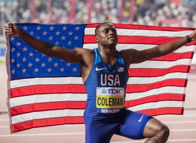 Christian Coleman celebrates his victory at the Men's 100m final.