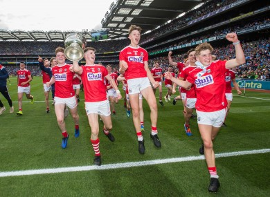 Cork players celebrate after the game.