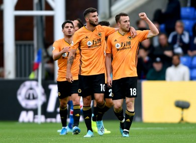 Diogo Jota is congratulated by team-mates after scoring for Wolves against Crystal Palace.