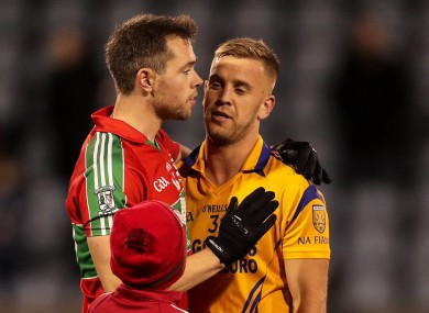 Dean Rock shakes hands with Jonny Cooper of Na Fianna after the game.