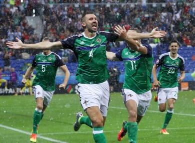 Gareth McAuley celebrates scoring against Ukraine at Euro 2016.