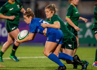 Grace Miller in action for Leinster, tackled by her sister Alison.