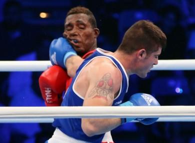 Ward lands a left hand on Cuban amateur nemesis Julio Cesar La Cruz during the 2017 World Championship final.