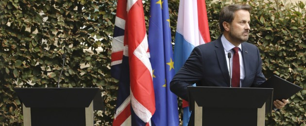 Luxembourg's Prime Minister Xavier Bettel, right, addresses a media conference next to an empty lectern intended for British Prime Minister Boris Johnson