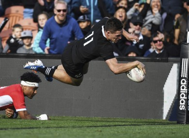 George Bridge dives over for a try against Tonga.