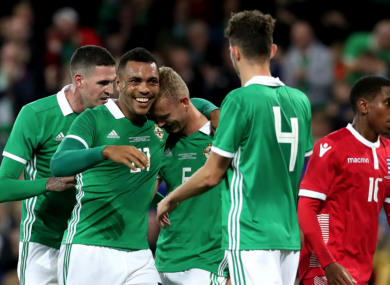 Northern Ireland celebrate Kevin Malget's own goal.