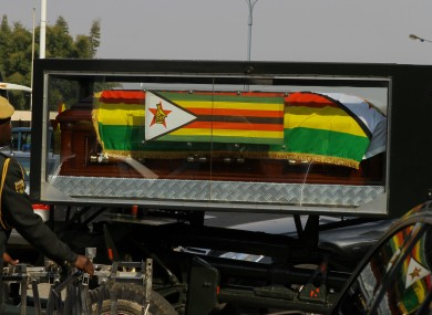 The body of former Zimbabwe's president Robert Mugabe leaves the National Sports Stadium where the international delegates, friends of Mugabe and other dignitaries paid last respect