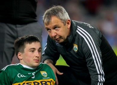 Kerry's Paul Murphy with manager Peter Keane after the game.