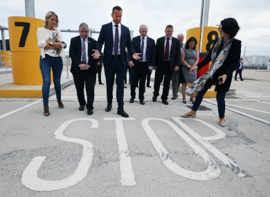 Taoiseach Leo Varadkar and European Affairs Minister Helen McEntee with port and customs officials during a visit to new physical infrastructure at Dublin Port.