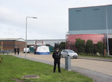 Police officers at the scene where 39 bodies were found in a shipping container in Essex.