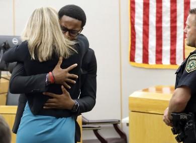 Brandt Jean hugs Amber Guyger at her sentencing hearing.